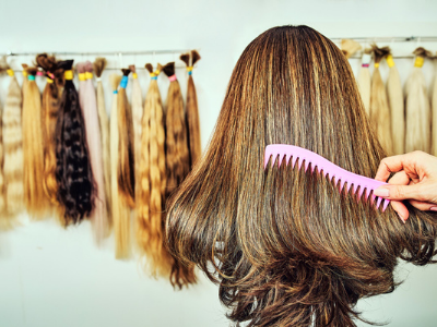 Blog Image: Combing Hair With Extensions in Background