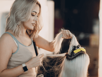 Blog Image: Professional Stylist Doing Extensions